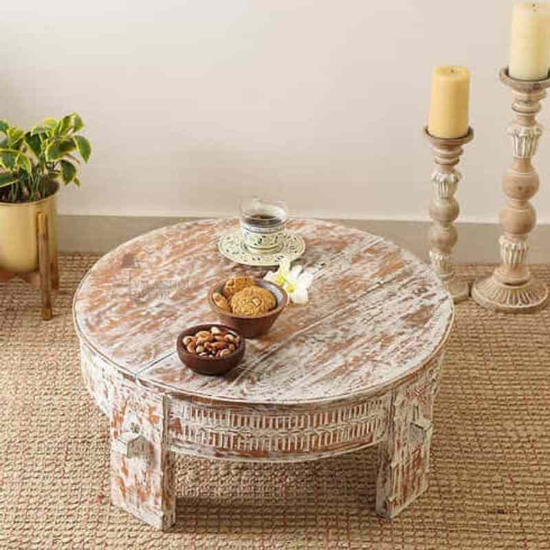 round carved coffee table